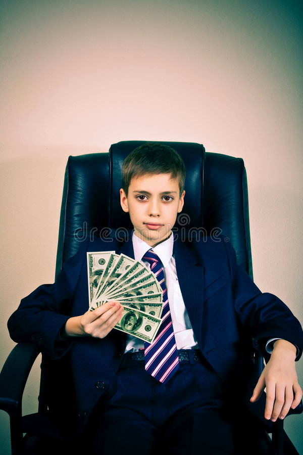 Young boss holding dollars. Portrait of confident young boss holding dollars stock photography