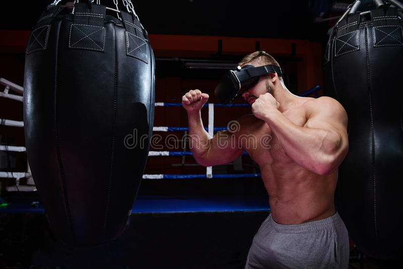 Young boxer during virtual fight royalty free stock image