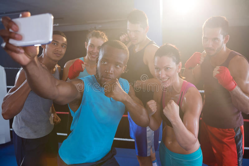 Young boxers taking selfie in fighting stance stock image