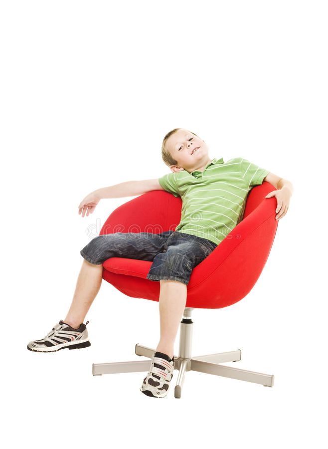 Download Young boy in an armchair stock image. Image of children - 15633413