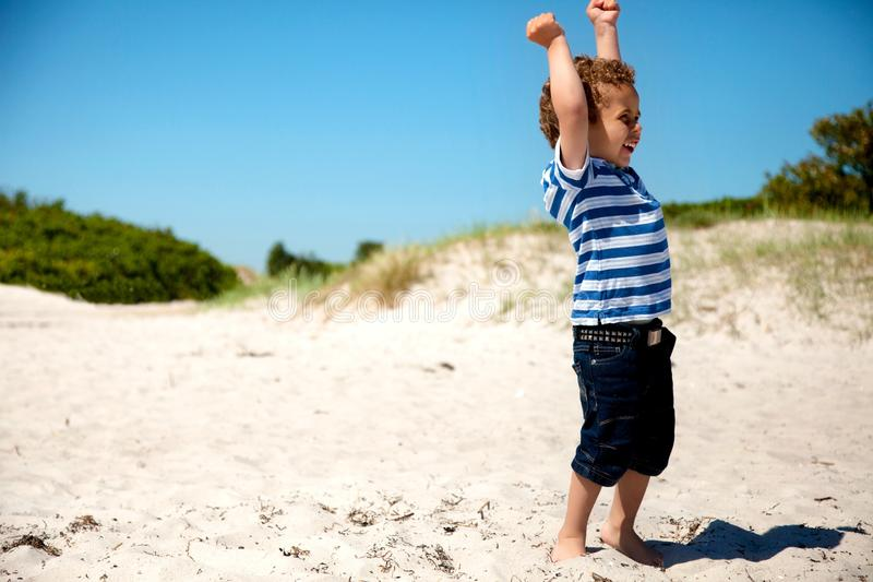 Download Young Boy  With Arms Stretched Looking Happy Stock Image - Image: 26078223
