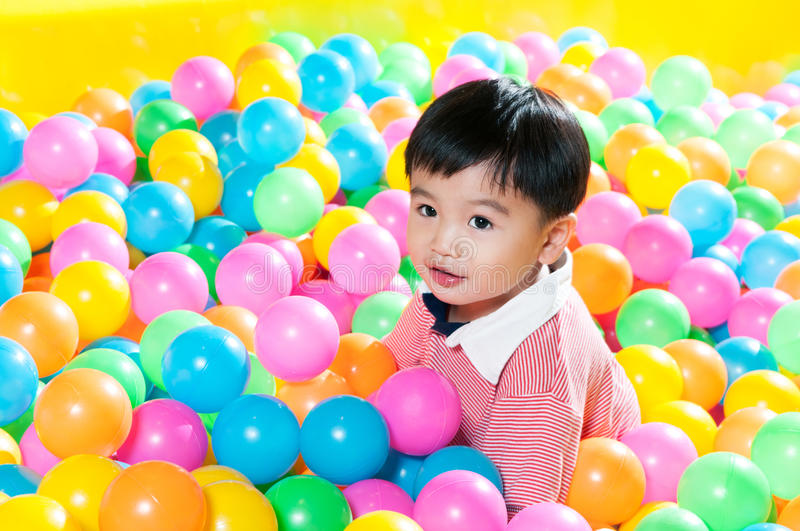 Download Young Boy In Ball Pit stock photo. Image of indoor, colored - 28362034