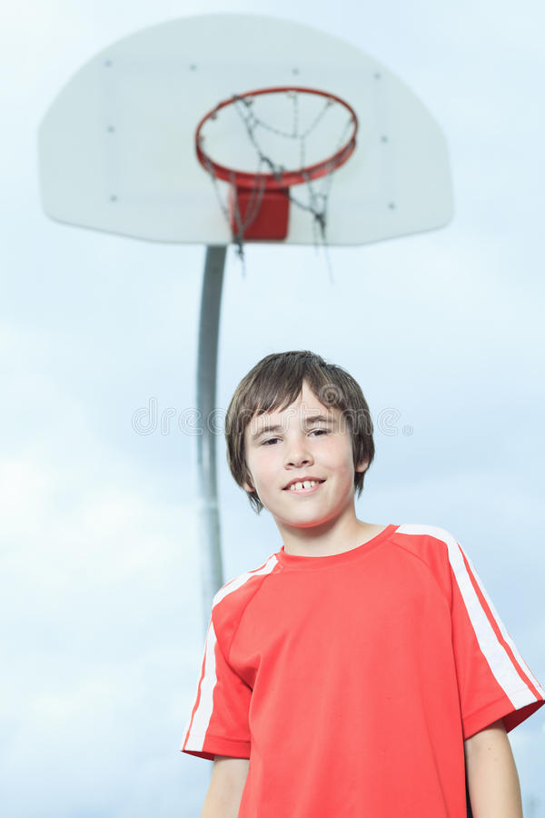 Young Boy In Basketball who having fun royalty free stock images