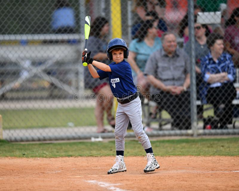 Young Boy batting during a Little League baseball game royalty free stock photography