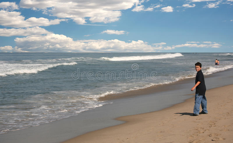 Young boy on beach royalty free stock photography