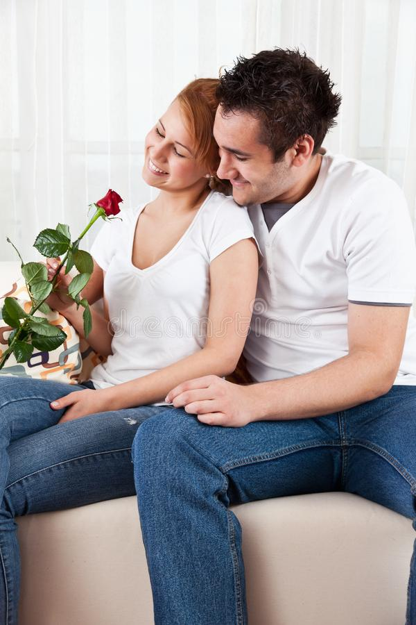 Young boy and a beauty girl with red rose royalty free stock image