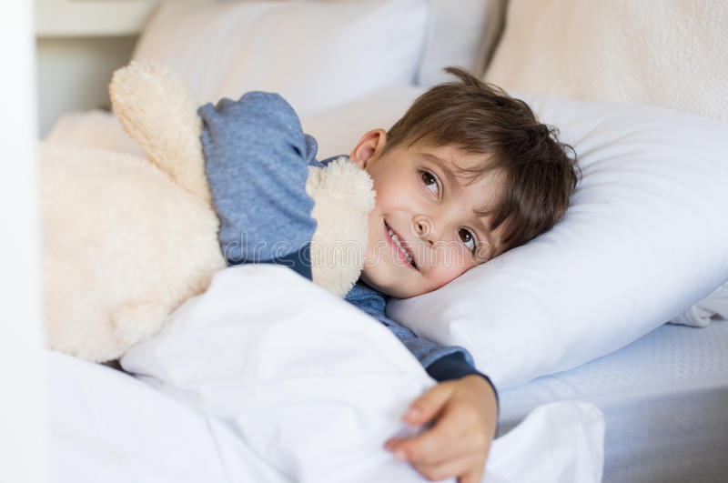 Young boy in bed stock photo. Image of embracing, sleeping ...