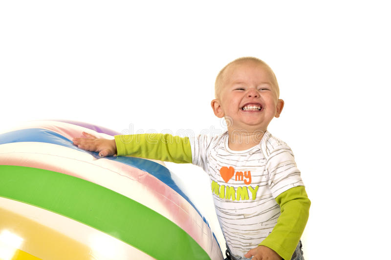 Young boy with big ball huge grin stock image