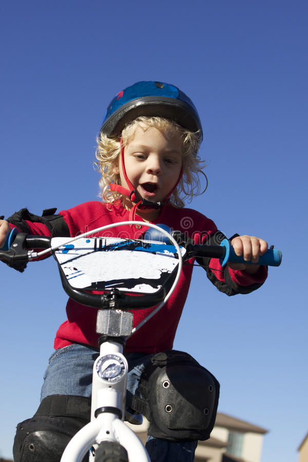 Download Young Boy on Bike stock image. Image of blonde, child - 18532957