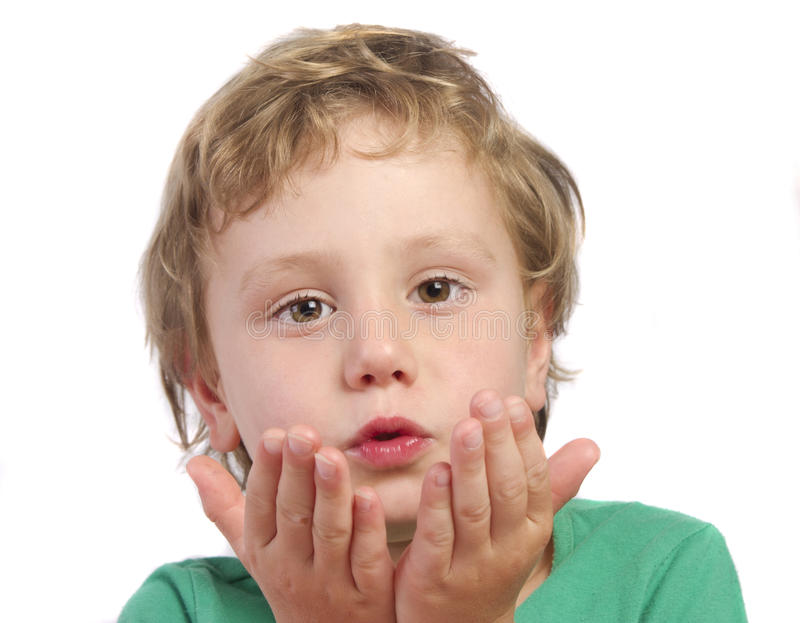 Young Boy Blowing Kisses Stock Image