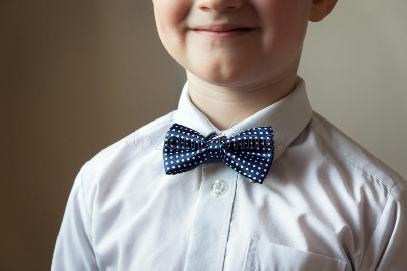 Young boy with blue bow tie. Smiling young boy with blue bow tie, portrait with copy space. Classical education or music for children concept royalty free stock photos