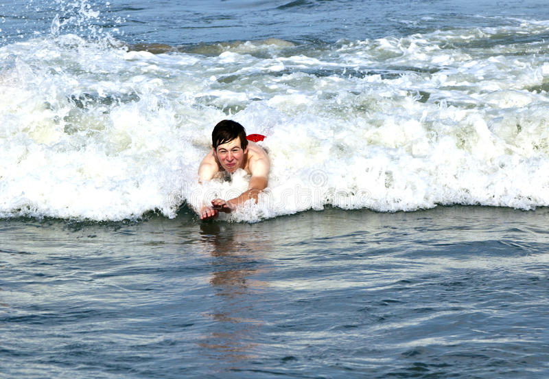 Download Young Boy Is Body Surfing In The Waves Stock Image - Image of outer, bodysurf: 17094873