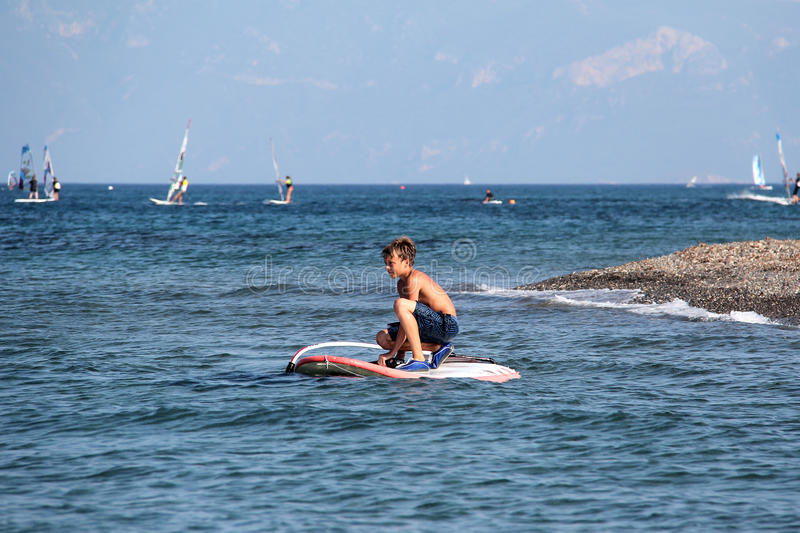 Download Young boy with boogy board stock photo. Image of young - 49672522