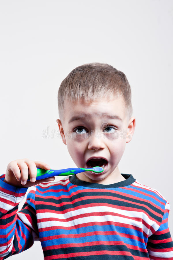 Young Boy brushing teeth royalty free stock photography