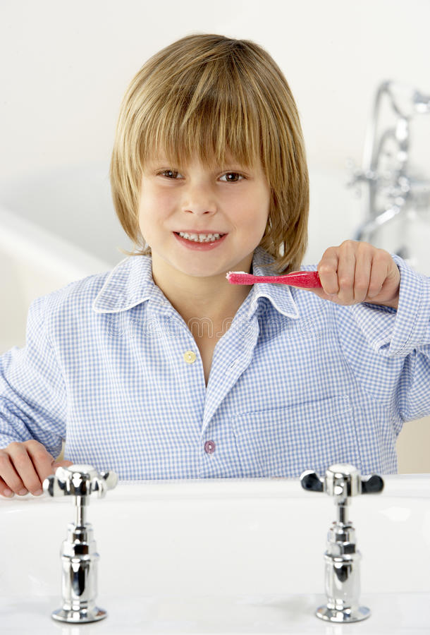 Young Boy Brushing Teeth at Sink. Cute Young Boy Brushing Teeth at Sink stock photos