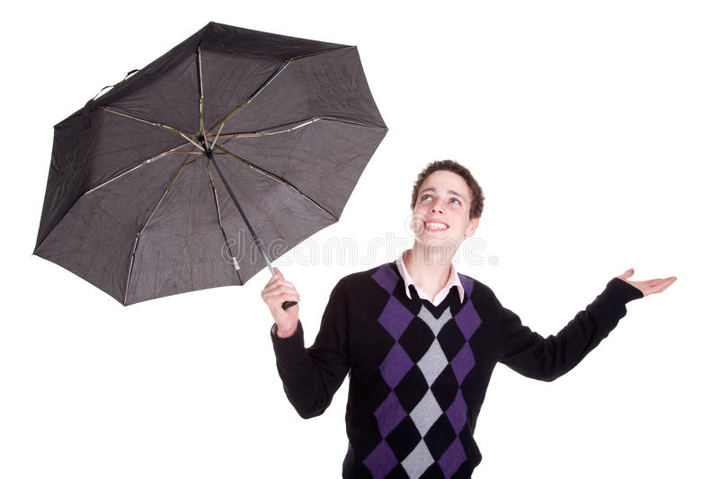 Young boy bypassing the umbrella, open arms stock photos