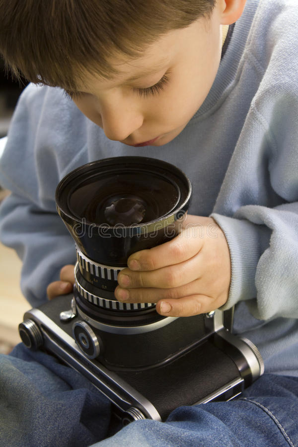 Young Boy With Camera Royalty Free Stock Image