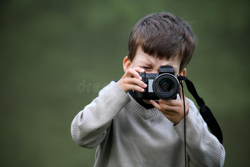 Young boy with an camera stock photography