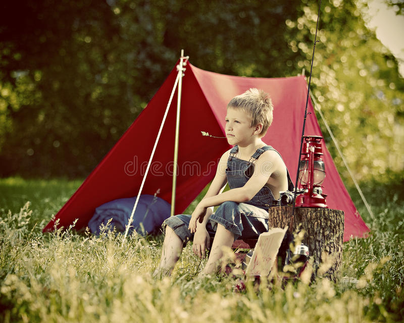 Young boy camping stock photos