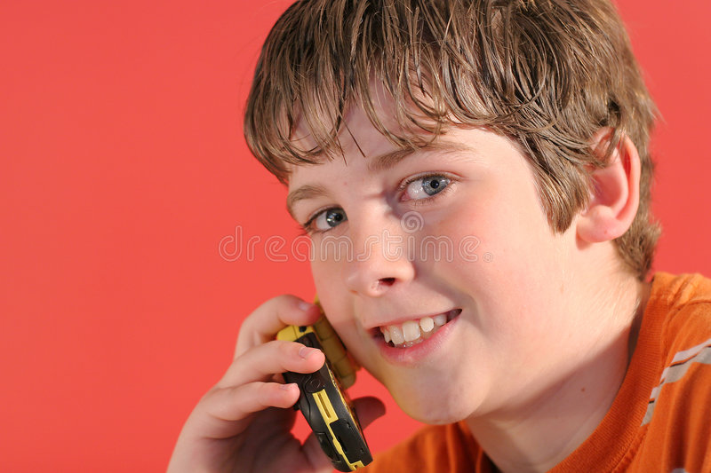 Young boy on cell phone stock images