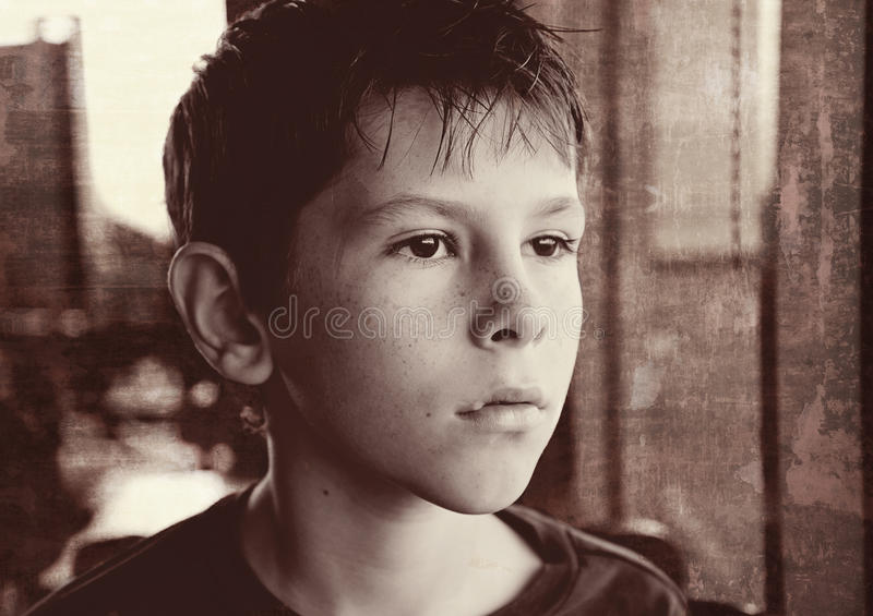 Young boy child black and white gazing stock image
