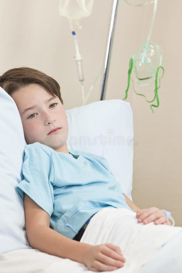 Young Boy Child Patient In Hospital Bed stock photography