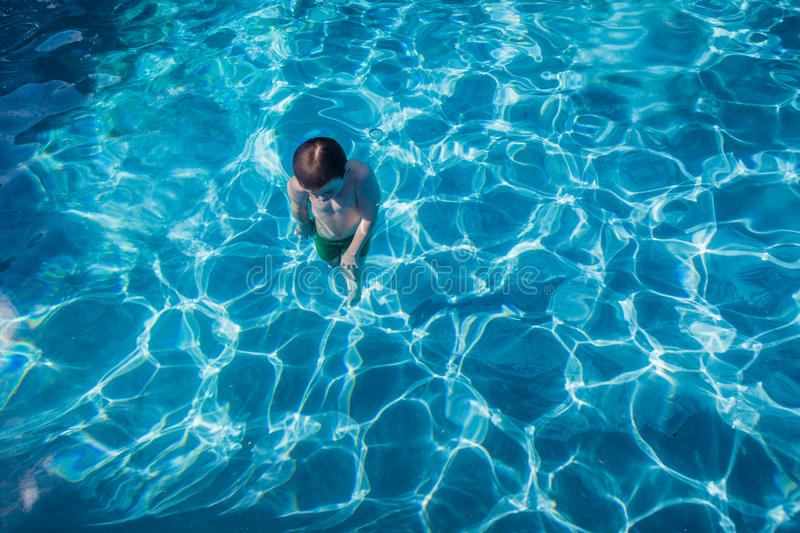 Boy Underwater Surfacing Pool Royalty Free Stock Images