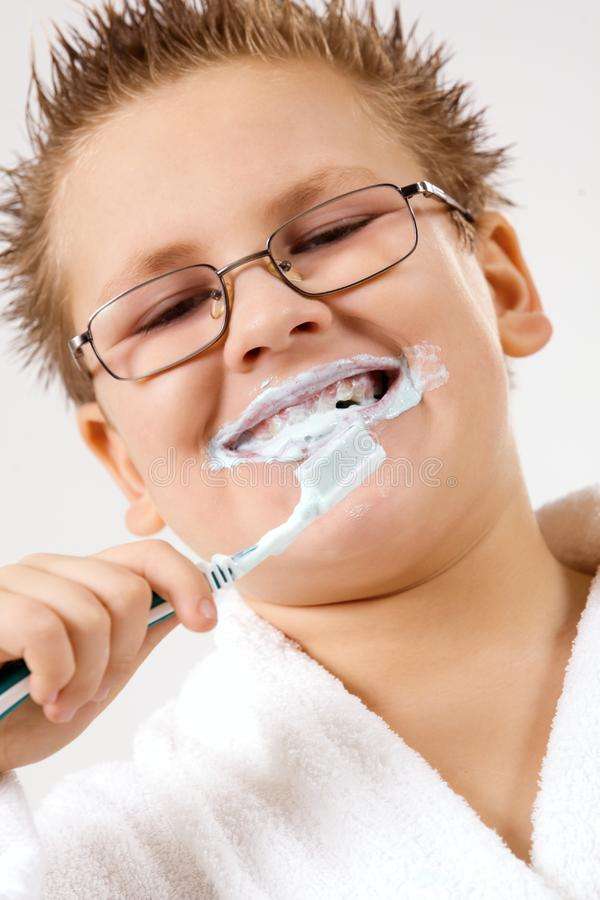 Young boy cleaning teeth stock images