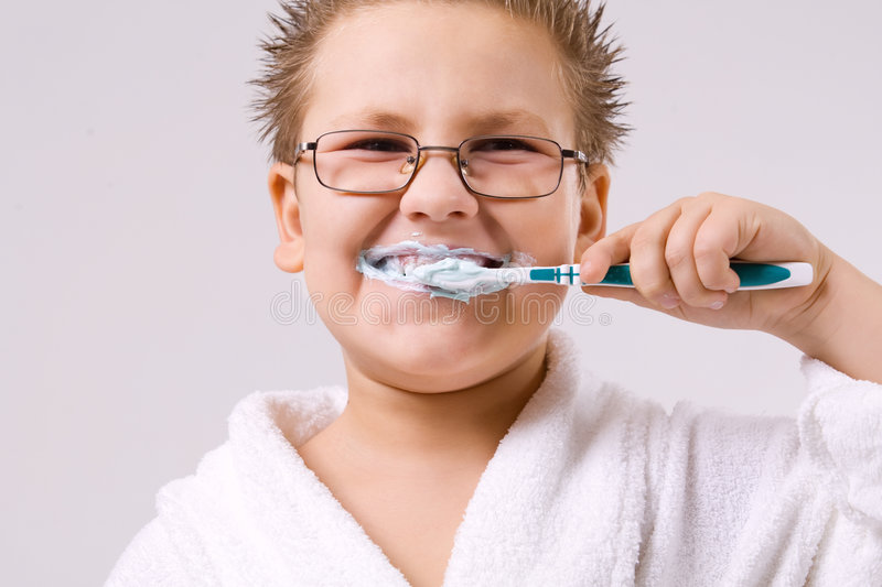 Young boy cleaning teeth stock photography