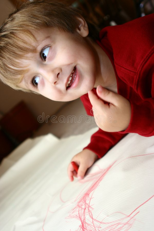 Young boy coloring royalty free stock image