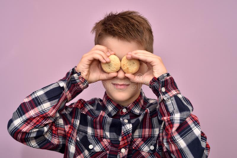Young boy with cookies instead of eyes royalty free stock photos