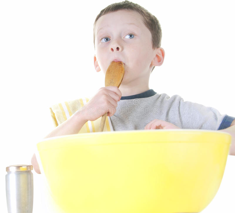 Download Young Boy Cooking And Tasting Stock Photo - Image: 17815434