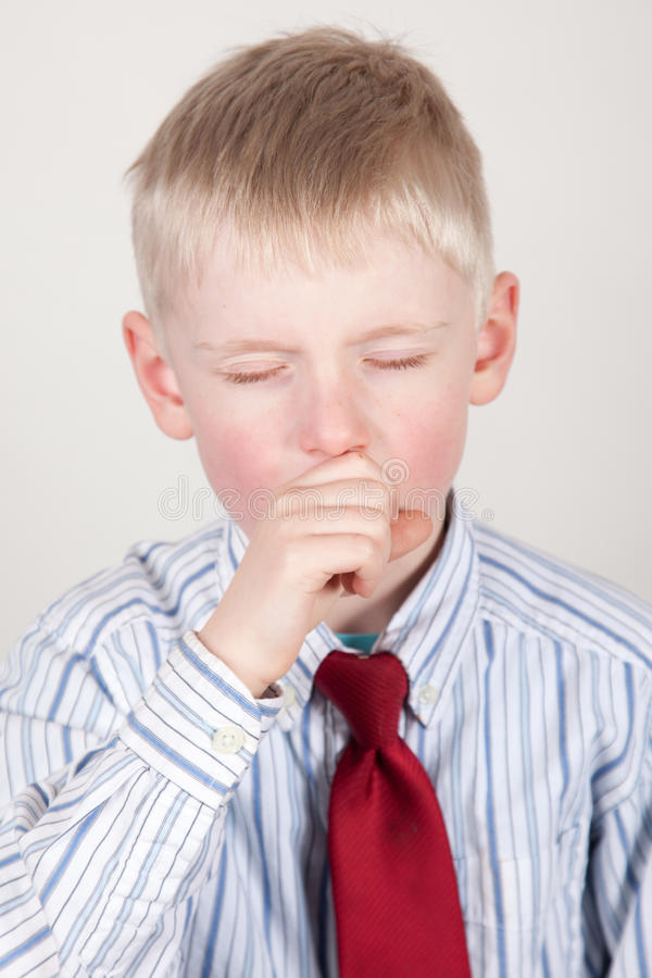 Young boy coughing royalty free stock image