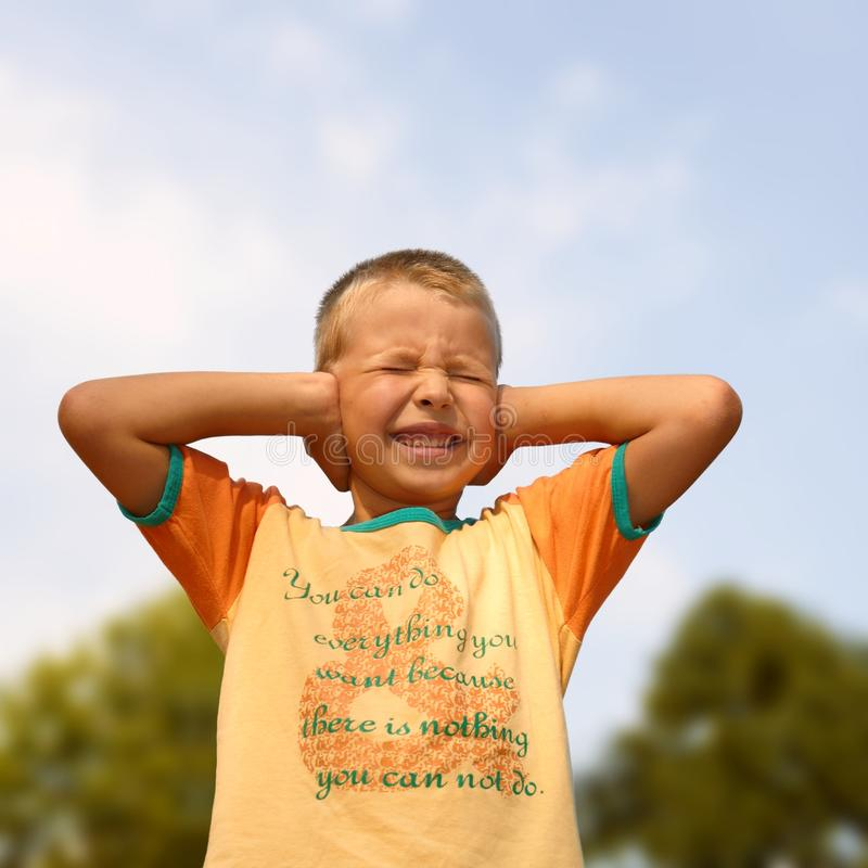 Download Young Boy Covering His Ears By Hands Stock Photo - Image: 15583288