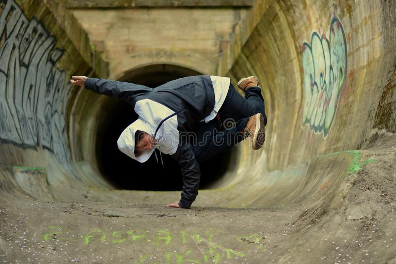 Young boy dancing break dance. On the street royalty free stock photography