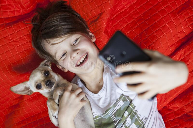 A young boy with a dog in a interior. stock photography