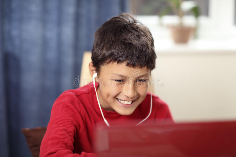 Young boy doing his homework stock images
