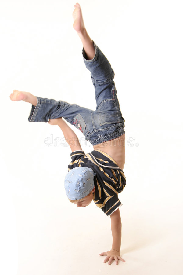 Young boy doing a one handed handstand stock photo