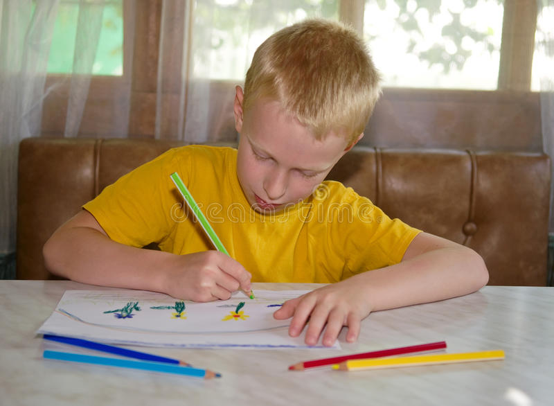 Young boy drawing royalty free stock photography