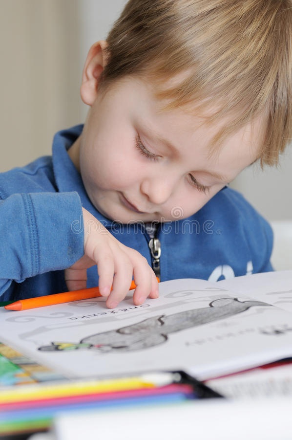 Young boy drawing stock image