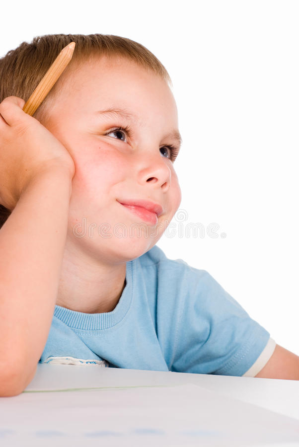 Young boy draws stock photo