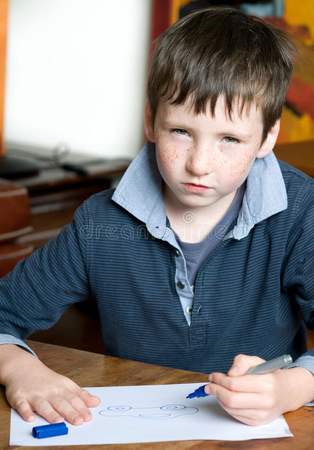 Young boy draws stock images