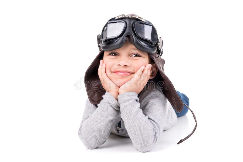 Young boy dream. Young boy with pilot helmet isolated in white stock images
