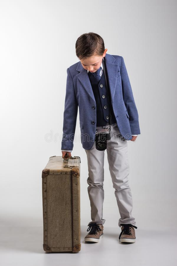 Young boy dressed up with photo camera and suitcase stock photos