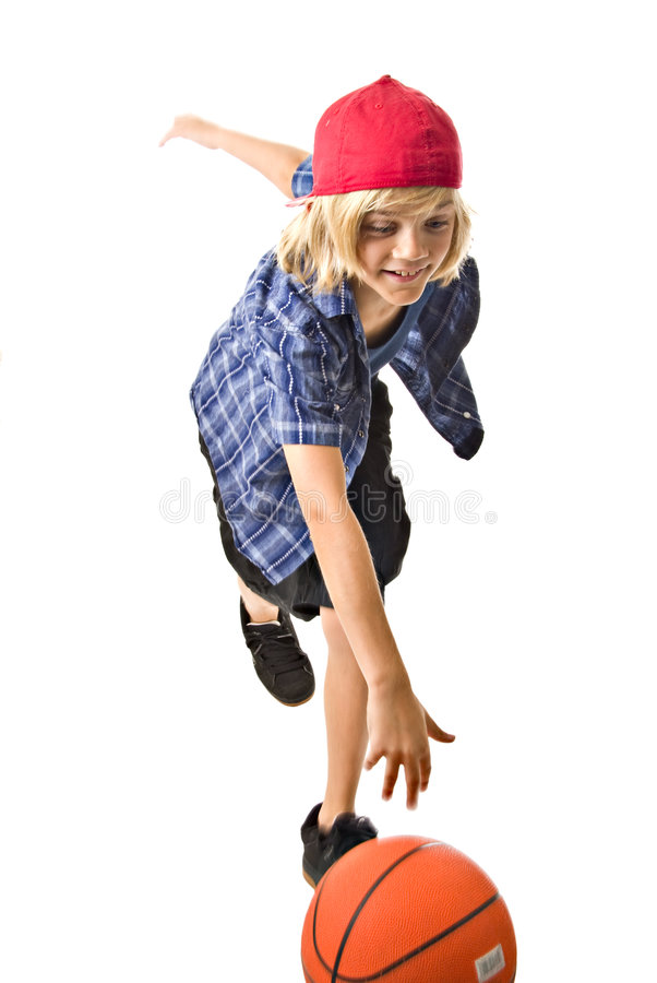 Young boy dribbling basketball royalty free stock images