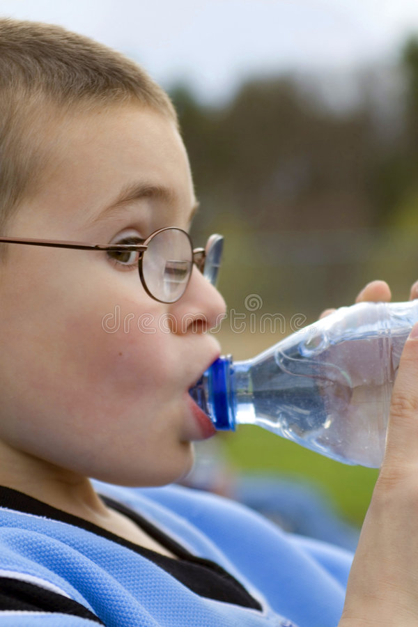 Young Boy Drinking Water royalty free stock photo