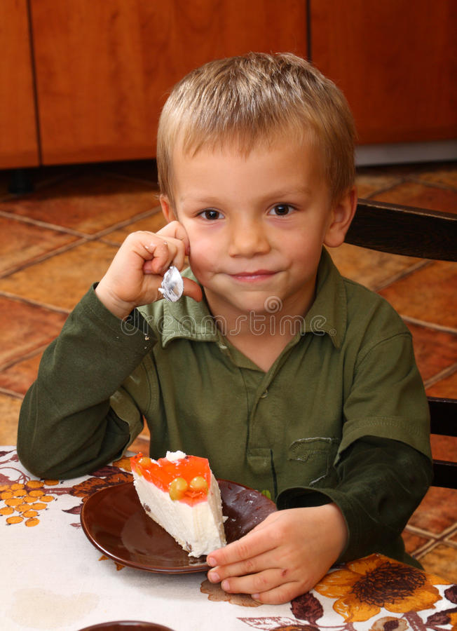 Download Young Boy Eating Cheesecake Stock Photography - Image: 16727532