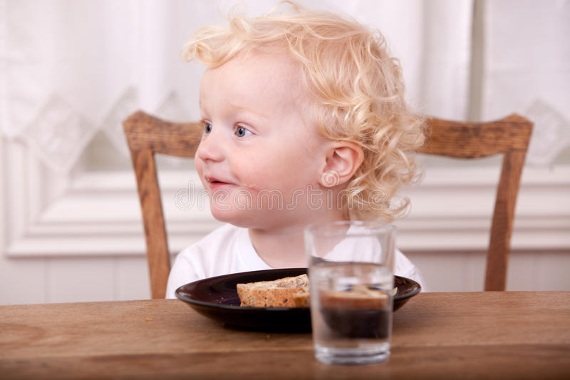 Young Boy Eating Lunch royalty free stock image