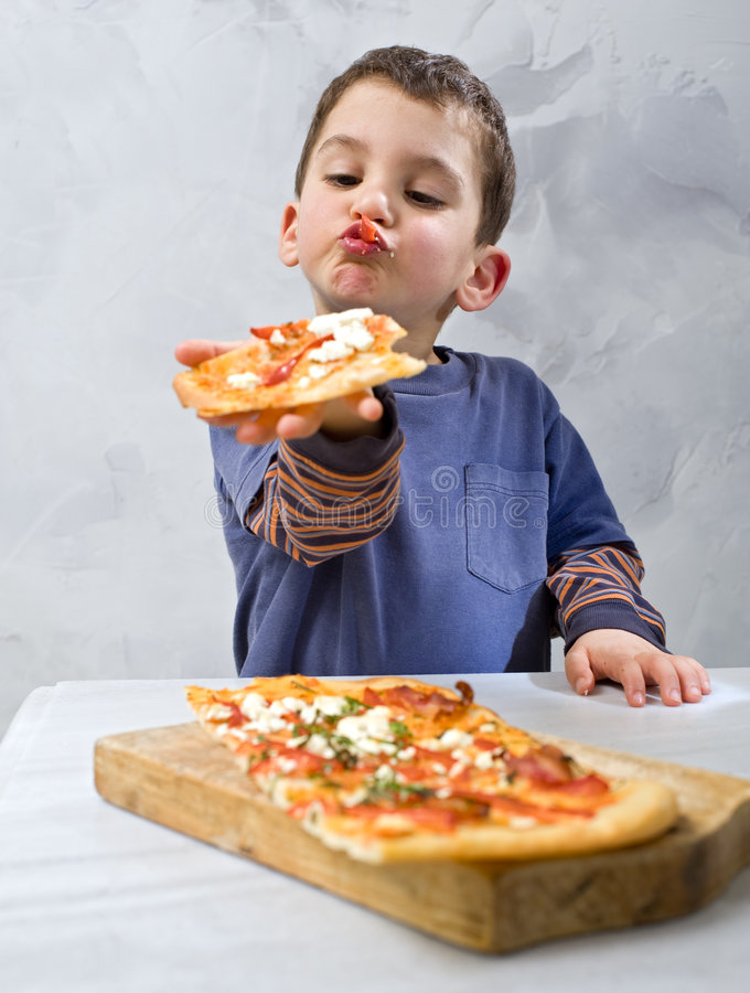 Download Young boy eating pizza stock photo. Image of adorable - 8667196