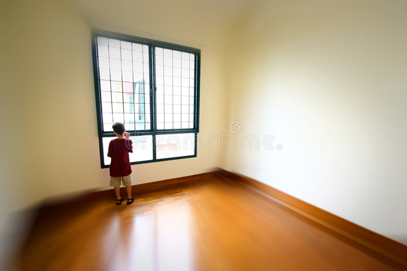Young boy in an empty room stock images